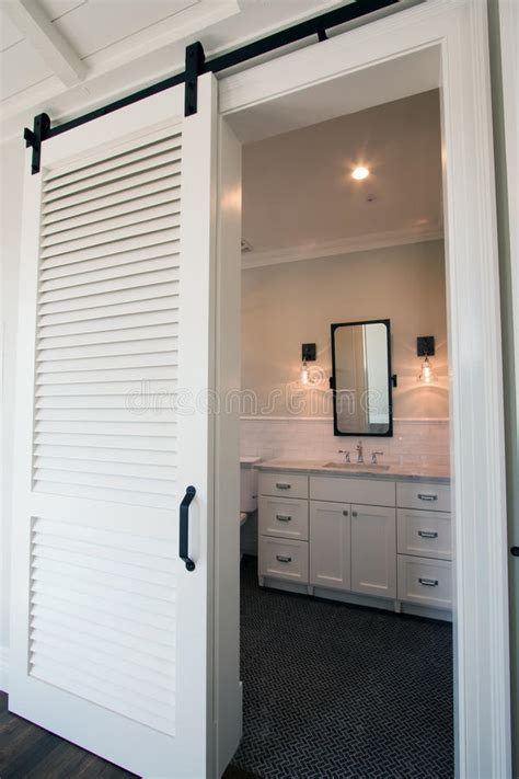 interior sliding barn doors  bathroom stock image