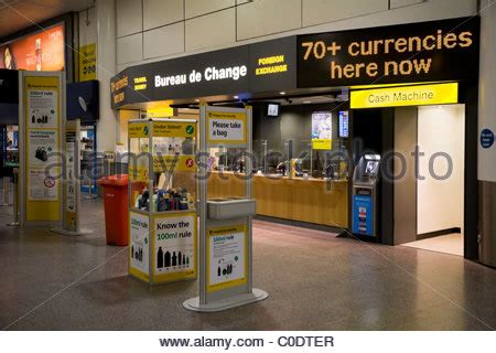 currency exchange bureau at gatwick airport stock photo