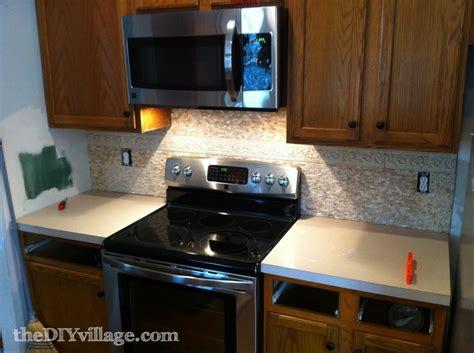 install kitchen backsplash installing a split travertine backsplash pretty