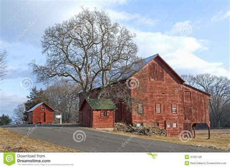 red barns  tree  country road stock image