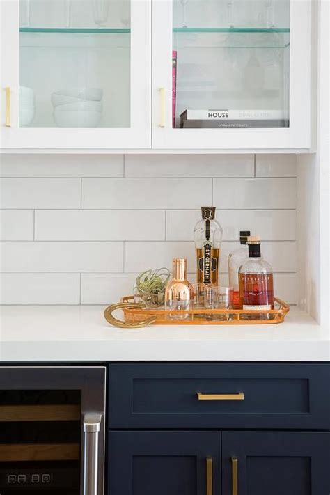subway tile for kitchen white and blue kitchen features navy blue shaker cabinets 5927