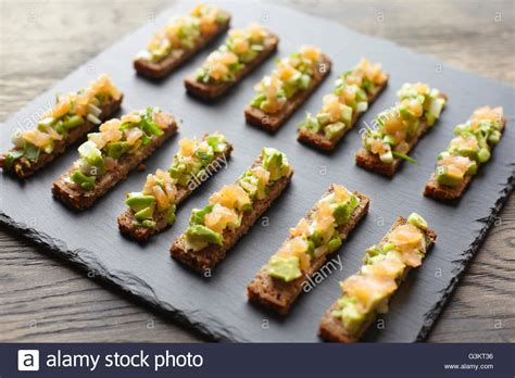 rye bread canapes guacamole smoked salmon and rye bread canapes stock photo royalty free image 105542170 alamy