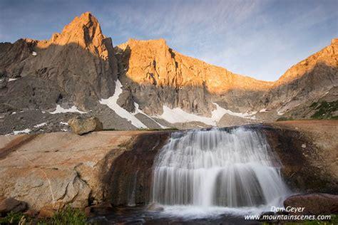 Waterfall below peaks of Cirque of the Towers