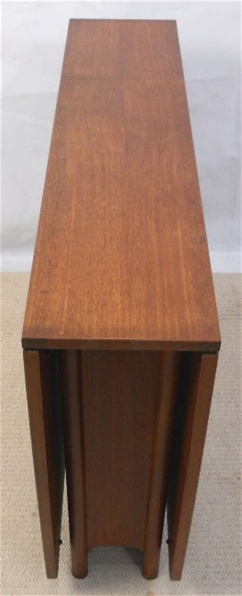 teak narrow spacesaver dropleaf dining table  seat  sold