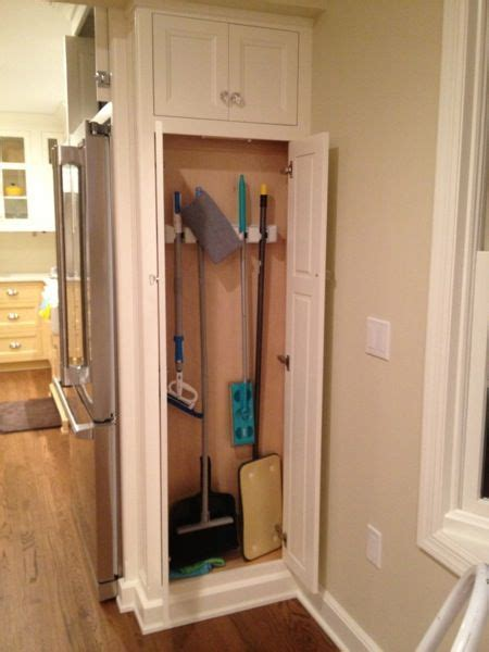broom and mop cabinet broom cabinet next to fridge our pantry which is 14 quot deep