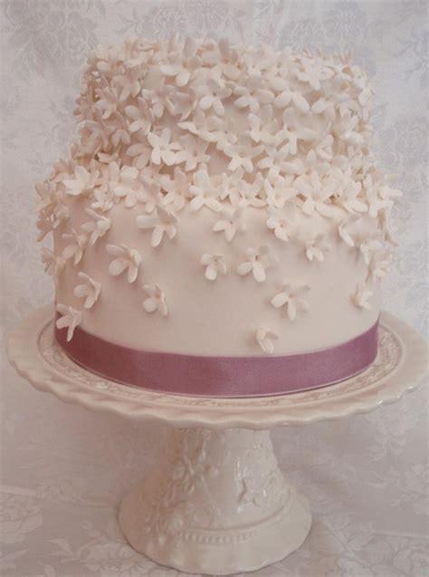 white floral engagement cake  pink ribbonpng