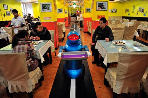 robo cuisine restaurants in china are now hiring robots as waiters and