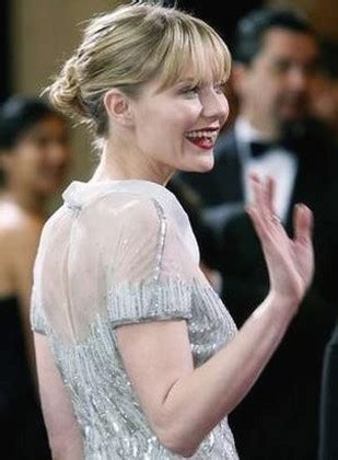 Kirsten Dunst With Simply Pinned Back Hair Style With Long