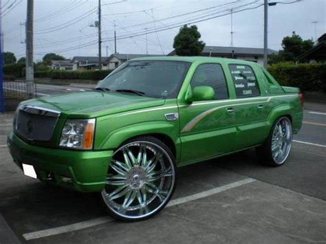 green cadillac escalade ext  big rims custom