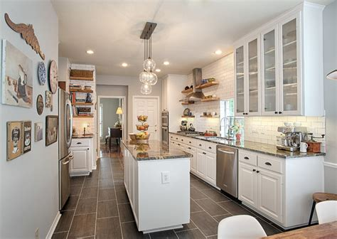 pictures of kitchens with white cabinets and black appliances transitional white kitchen 9944