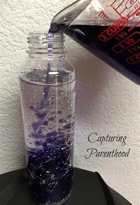 oil water galaxy sensory bottle capturing parenthood