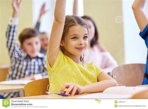 group  school kids  notebooks  classroom stock