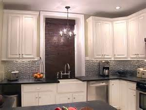 black and white kitchen canisters silver backsplash black countertops white cabinets home black counters