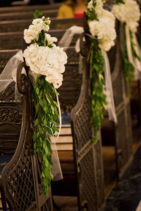 orleans wedding catholic wedding fat cat flowers pew