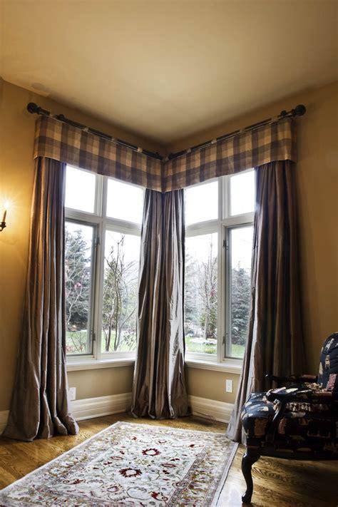 corner windows with masculine window treatment interior