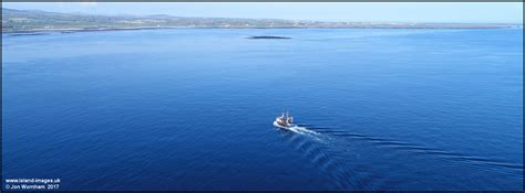 pictures of aerial view of fishing vessel in bay ny carrickey isle of