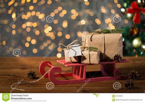 close   christmas gift boxes  wooden sleigh stock