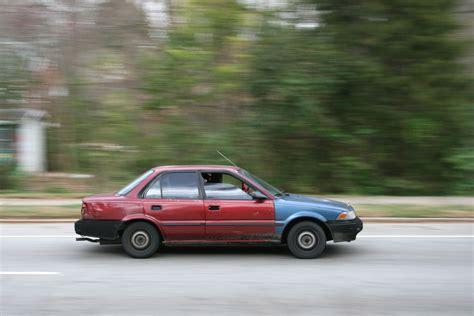 rusty car driving file 2009 03 11 beat up car driving in durham jpg