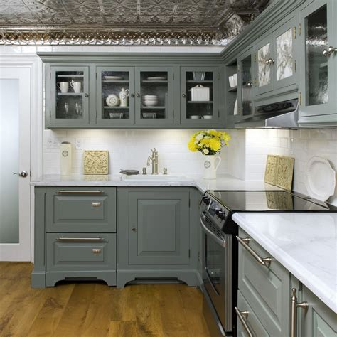 combinate gray kitchen cabinets with black appliances