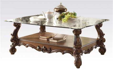 It is made of wood and covered with white coat of lacquer. Versailles Traditional Cherry Oak Rectangular Glass Top Coffee Table