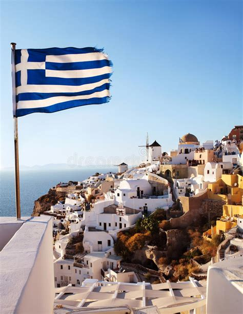 Oia Santorini Windmill On Cliff Side And Greek Flag