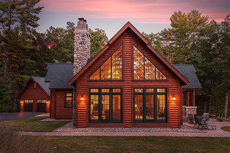 Chalet Designs by Hybrid Log Lake Home Side View Of Large Patio Doors And