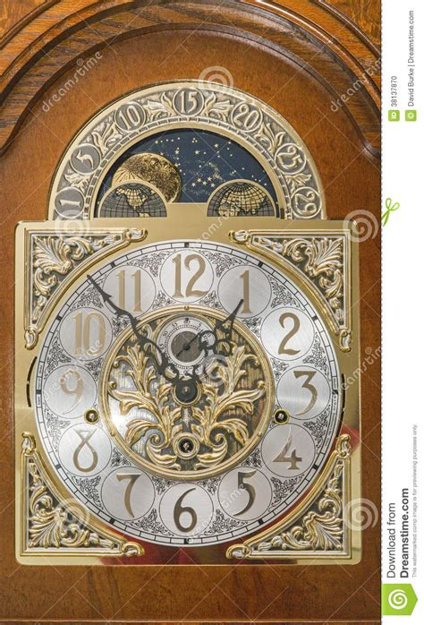 grandfather clock face wooden case moving moon dial stock