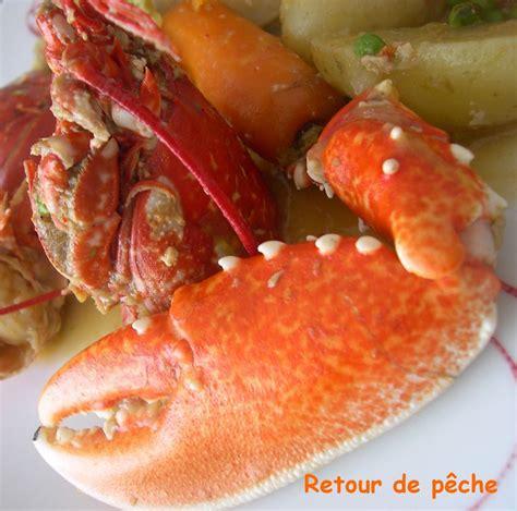 cuisiner homard vivant homard breton en cocotte aux legumes nouveaux recette