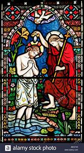 A stained glass window depicting the baptism of Jesus ...