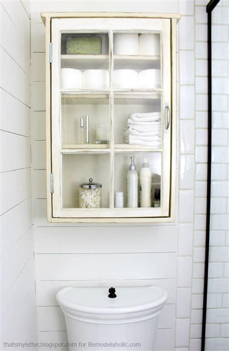 Bathroom Storage Cabinet by Remodelaholic Bathroom Storage Cabinet Using An Window