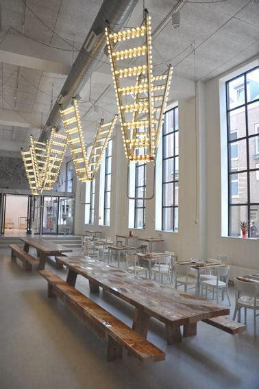 repurposed ladder   giant chandelier recyclart