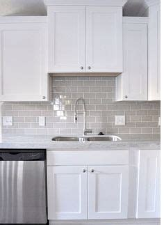 kitchen cabinets used for kitchen with gray subway tiles transitional kitchen 8157