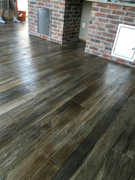 hardwood flooring on concrete concrete stained and textured with overlayment to look like wood plank absolute favorite