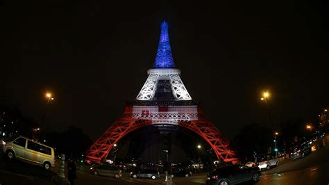 red white and blue lights vive la france world landmarks light up in red white and