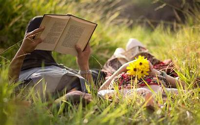 Romantic Couple Reading Lying Grass Wallpapers