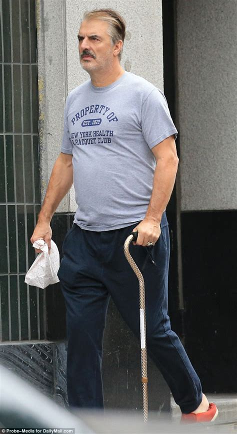 Chris Noth, 62, hobbles along in NYC with walking cane   Daily Mail Online