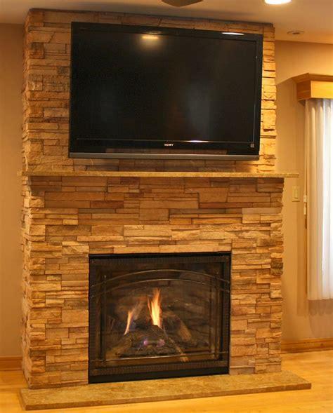 ledgestone fireplace and tv setup bittern family room