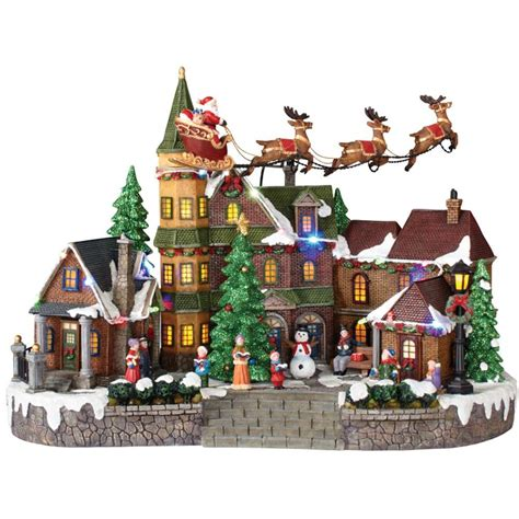 animated christmas village with train home accents 12 5 in animated musical led with santa sleigh nm x11647fa the