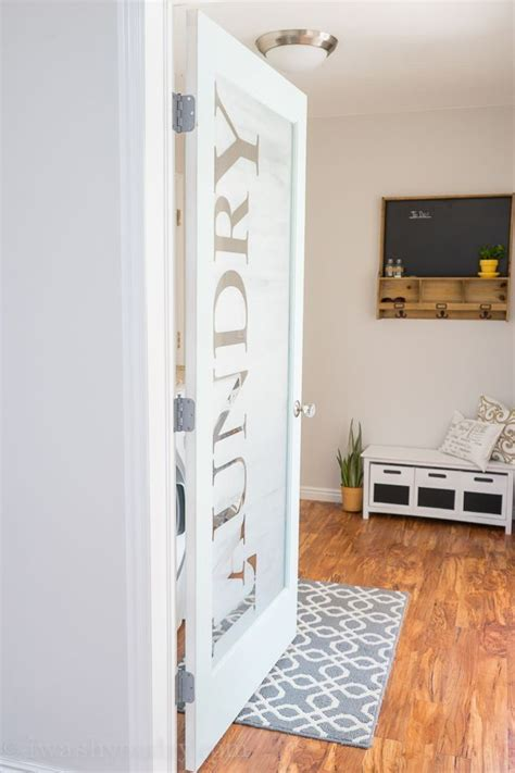 LOVE this Laundry Room door! She uses vinyl letters then