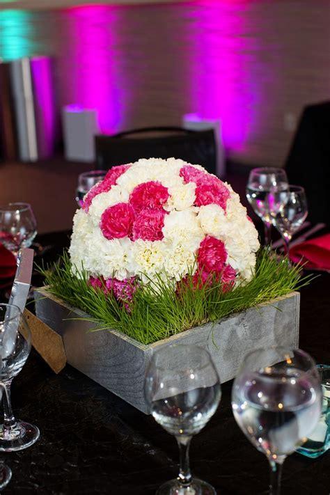 Floral centerpiece bat mitzvah soccer theme hot pink