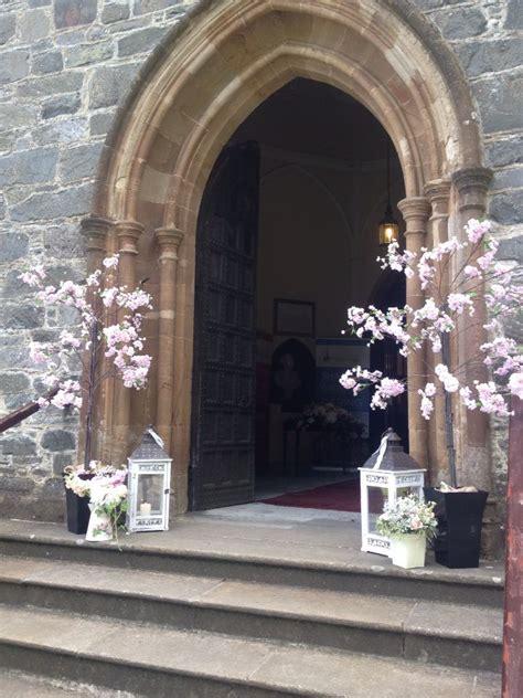 posy barn blossom trees outside church wedding ideas