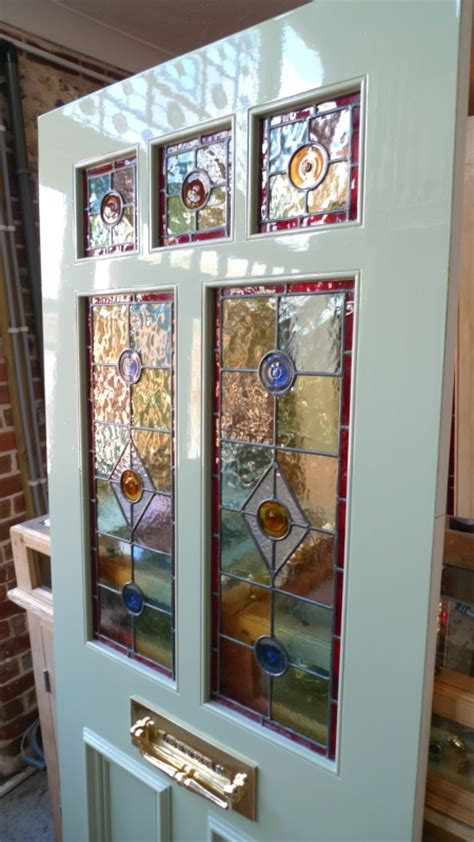 victorian style stained glass front door incorporating