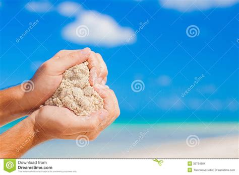 Man Hands Holding White Tropical Beach Form Heart Stock