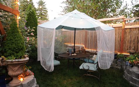 how to mosquitoes on patio mosquito net draped a sea foam green umbrella and pat