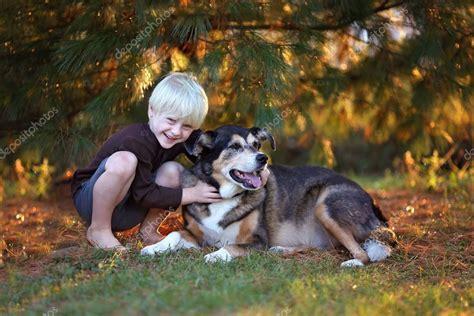 Sort by album sort by song. Cute Little Boy Hugging His Pet German Shepherd Mix Dog ...