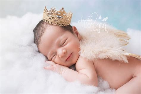 adorable newborn baby boy floating   cloud wearing