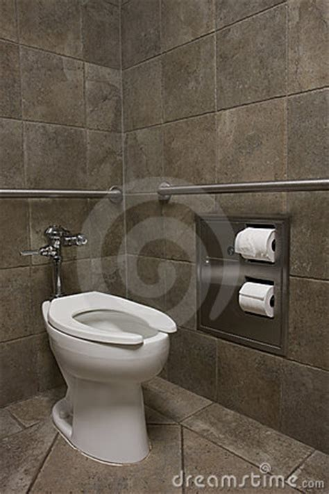 clean white toilet   public restroom royalty  stock