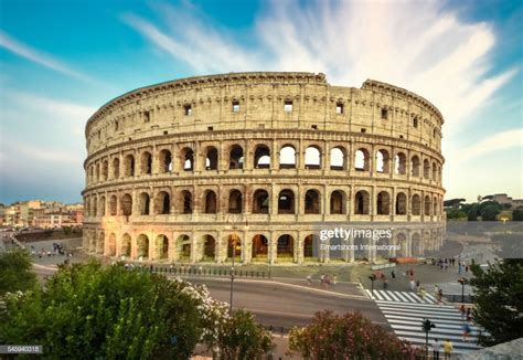 Free Colosseum In Rome by Colosseum With Dramatic Sky At Sunset Rome Italy