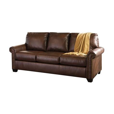 leather sleeper sofa queen ashley lottie leather queen sleeper sofa in chocolate