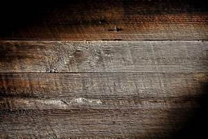 old and distressed antique grey board made of rough sawn With barn board planks